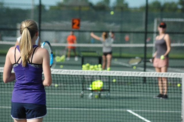 Morgan+Gierman%2C+senior%2C+stands+ready+to+return+a+serve+by+head+coach+Jinger+Shorette+at+practice+on+Aug.+31.%0A