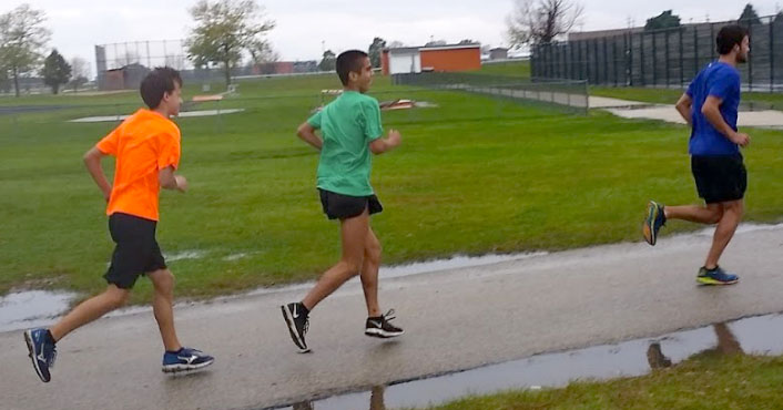 Senior+Justin+Tutt%2C+sophomore+Seth+Joder%2C+and+senior+Matt+Mason+start+their+road+run+on+a+rainy+day+of+practice.++%E2%80%9CThe+run+felt+good.+It+was+nice+and+cool+out%2C%E2%80%9D+Tutt%2C+said.++Although+he+faced+challenges+this+season%2C+Tutt+looks+to+his+teammates+to+remind+him+to+stay+positive+and+keep+his+confidence+high%2C+because+cross+country+has+a+way+to+reward+the+runner+who+really+want+to+succeed.+
