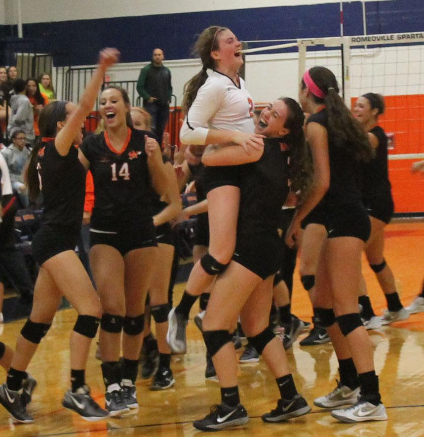 The+girl+volleyball+team+celebrates+their+win+over+Plainfield+Central+on+Nov.+3.+Minooka+won+the+sectional+title.+