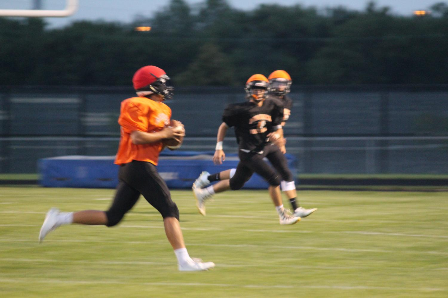 Senior+quarterback+Zach+Gessner+looks+to+pass+at+the+Meet+the+Indians+scrimmage+on+Aug.+18.+