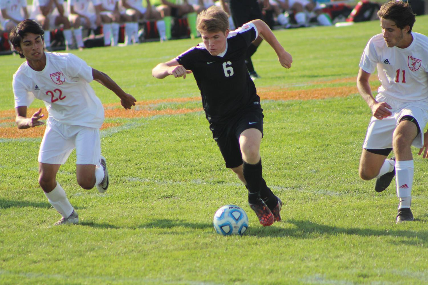 Junior Ryan Felgenhauer takes the ball against Naperville Central on Aug. 23.  The game ended in a 1-1 tie.