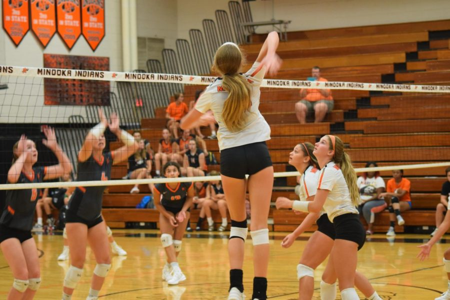 Heidi Bonde, sophomore, prepares to spike the ball against her opponents on Aug. 17 at Meet the Indians.