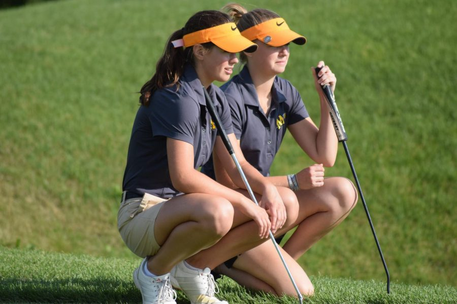 Abby Pettigrew and Megan Chiappetta eye up a shot at Heritage Bluffs on Aug. 23 when Minooka beat Plainfield East.