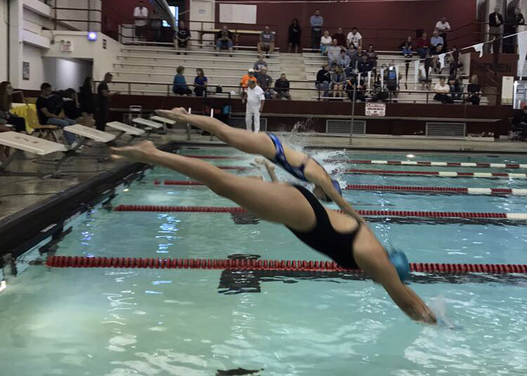 Minooka senior Steph Melendez starts the 50-meter fly at a meet in September against Dekalb. Melendez is one of several Minooka athletes who compete with the name