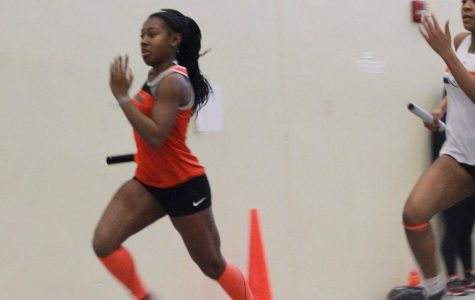 Sophomore Kyndall Ross leads off the 4x200-meter relay at the Wheaton Warrenville South Invitational on Feb. 9. The relay team finished fifth.