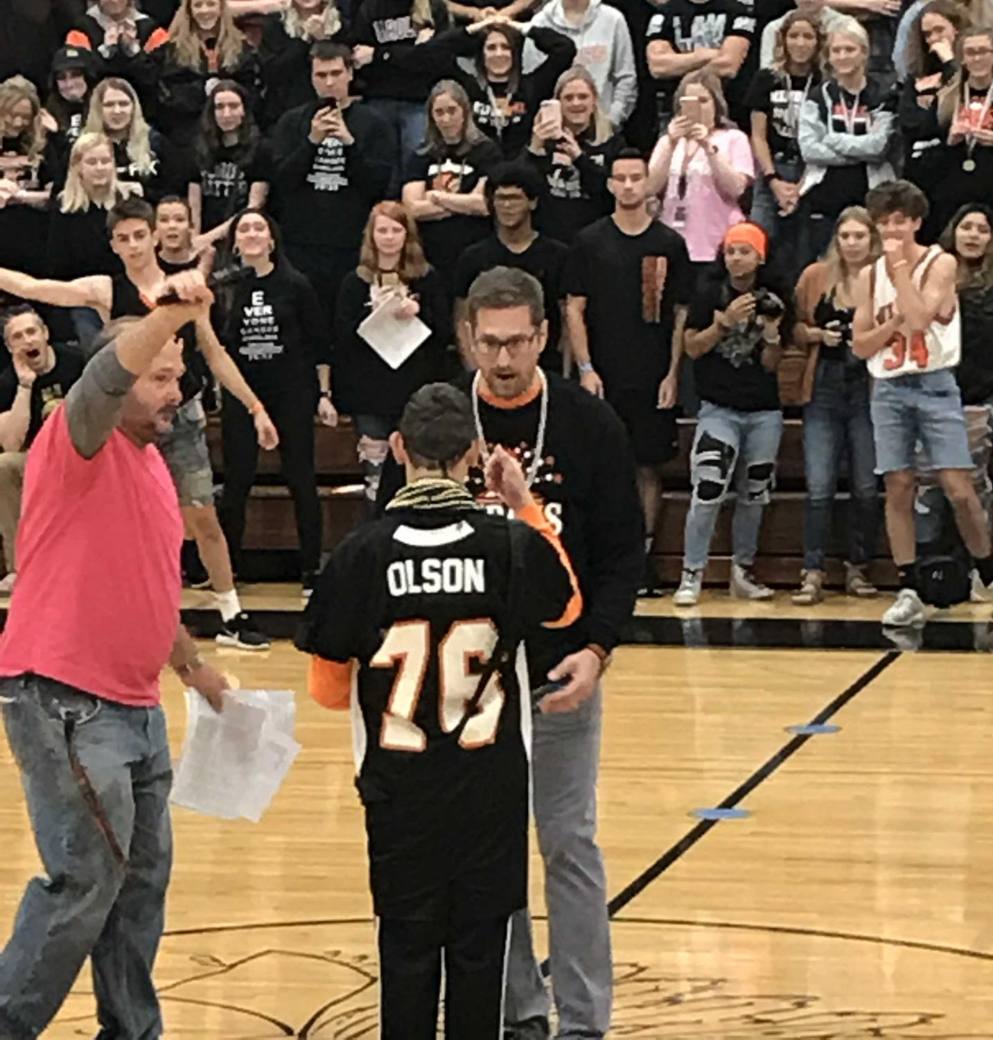 Alex Olsen defeats Principal Bryan Zwemke during the rock-paper-scissors competition at Central Campus during the Homecoming assembly.