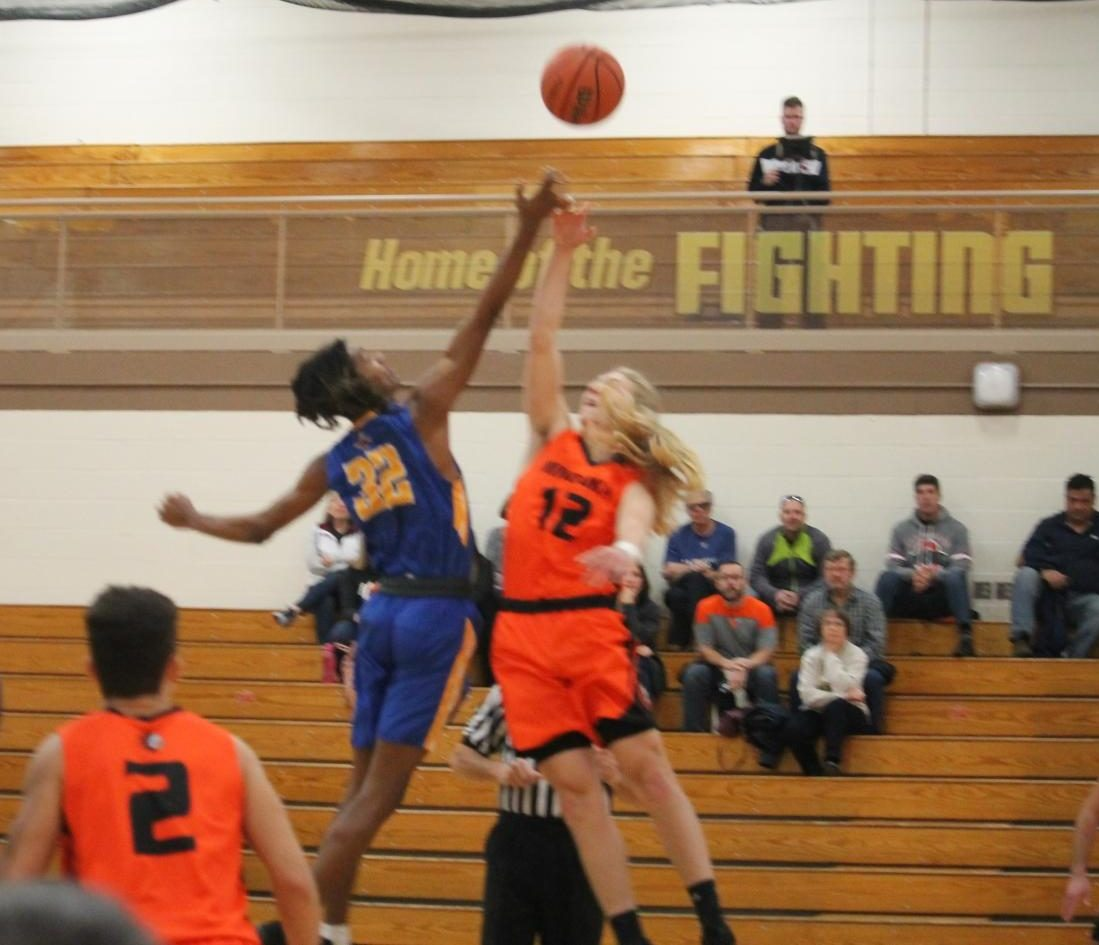 Shane Ooms tips the jump ball to start a game against Joliet Central at the WJOL tournament in November.