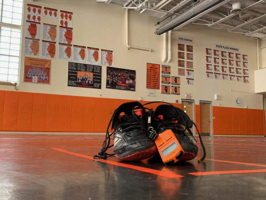 Rudy leaves his shoes on the mat after his final practice at MCHS.