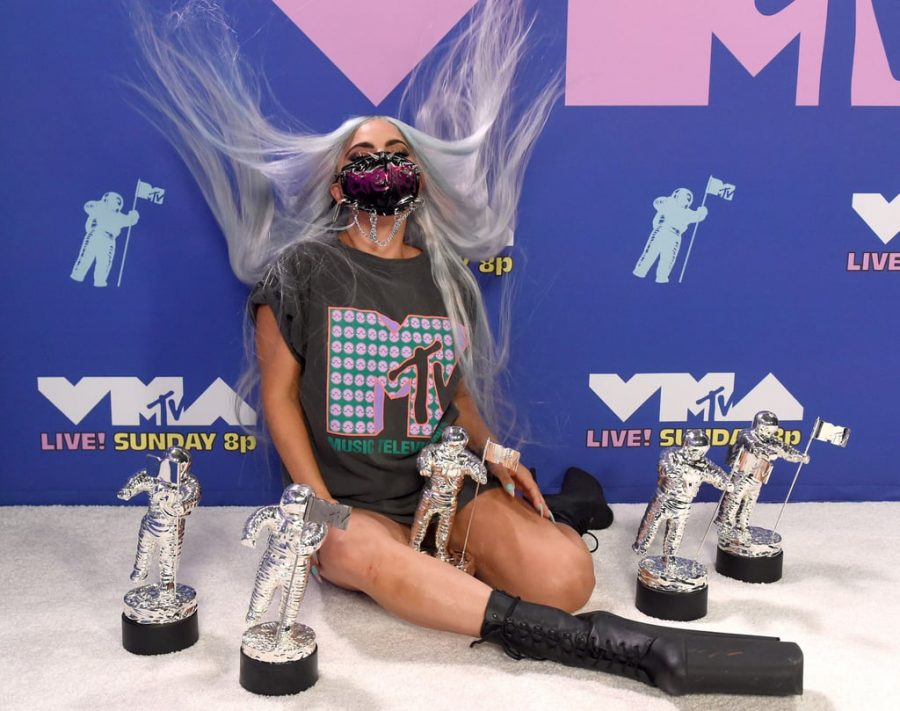 Lady Gaga, the biggest winner of the night, poses with her 5 VMAs she won throughout the show for Artist of the Year, Song of the Year, Collab of the Year, Best Cinematography, and the first ever Tricon Award.
