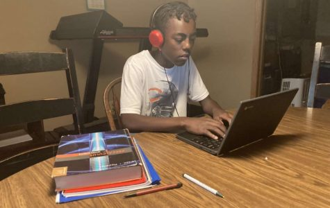 Junior Yirga Boeringa works at his designated remote learning area. Many students have found a place at home to be focused while they are in their classes. Others have just been comfortable in their beds.