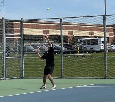 Junior Hayden Dela Cruz serves at a Lockport Tournament.