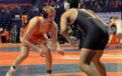 At the 2020 IHSA State Finals, Jack McClimon wrestles for Minooka.