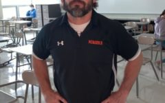 This is Mike Kimberlin's first year as head coach of the Minooka wrestling program.
