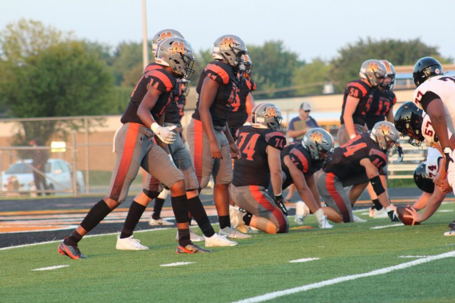 Minookas+defense+lines+up+in+an+early+season+game+against+Bolingbrook.+
