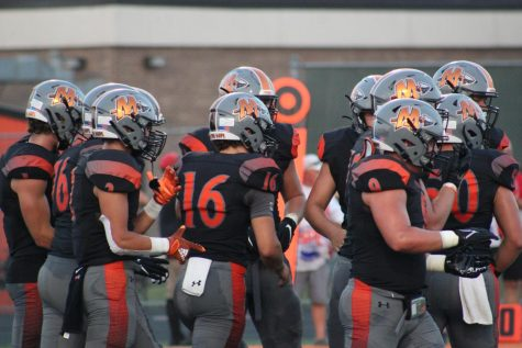 Minooka takes the field during its first home game against Bolingbrook.