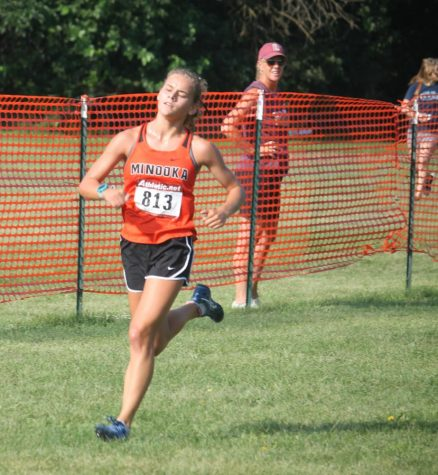 Junior Ella McCollom runs at the Normal West Invitational.  Later at the Minooka Conditioner, McCollom teamed up with Gabby Kics to win that race.