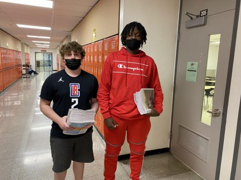 Sports editor Cole Pearson and news editor Drake Hayes deliver the student newspaper on Oct. 5.